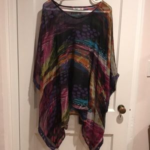 Colorful sheer poncho top with purple trim.